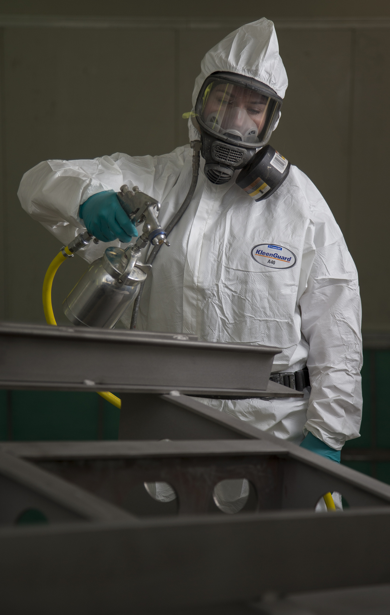 Seaman Boatswains Mate Georgia Christie prepares to paint a bilge keel in a spray booth that was transferred from the Air Force to the HMAS Stirling Fleet Support Unit's Corrosion Control section.