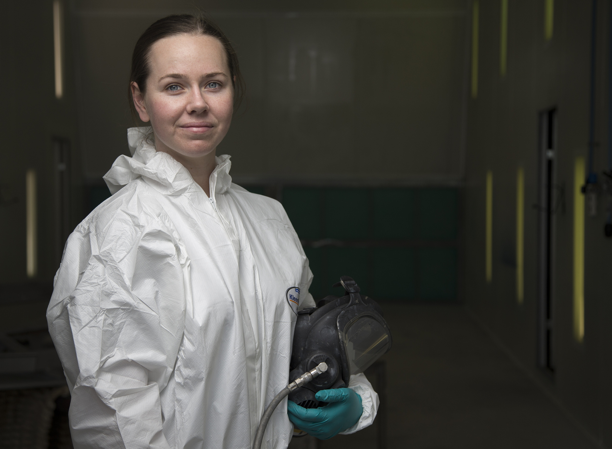 Seaman Boatswains Mate Georgia Christie in a spray booth that was transferred from the Airforce to the HMAS Stirling Fleet Support Unit's Corrosion Control section.